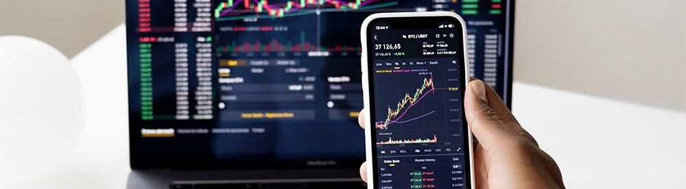 Current market of Bitcoin on phone and laptop
