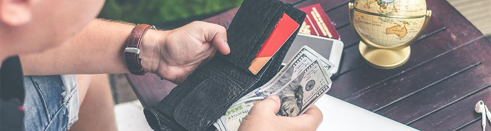 Man holding a wallet and money