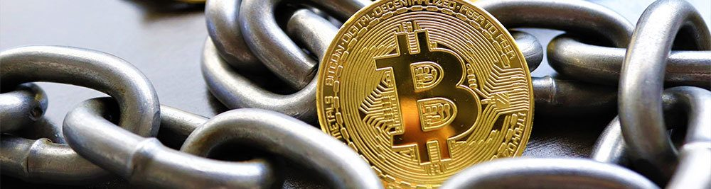 Bitcoin with chains in the background