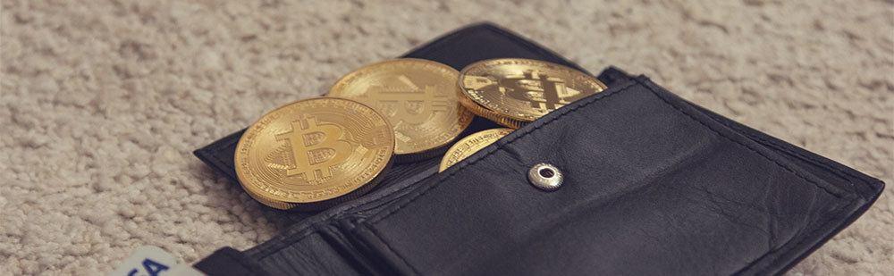 Gold Bitcoin inside a wallet
