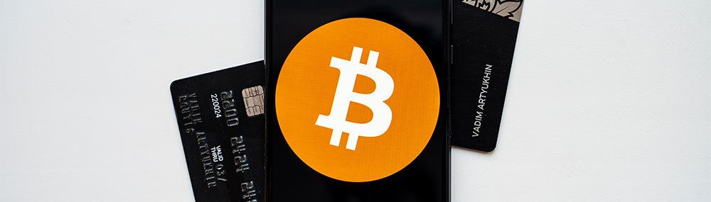 Smartphone showing Bitcoin with credit card on a white background