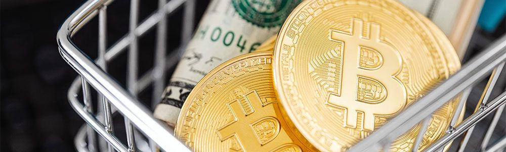 Bitcoins and dollar in shopping cart