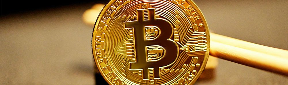 Gold bitcoin propped up against chopsticks