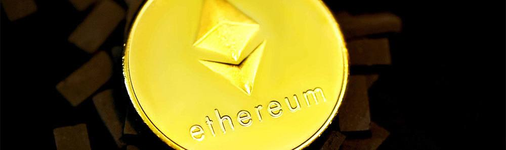 Ethereum coin on top of small bricks on black background