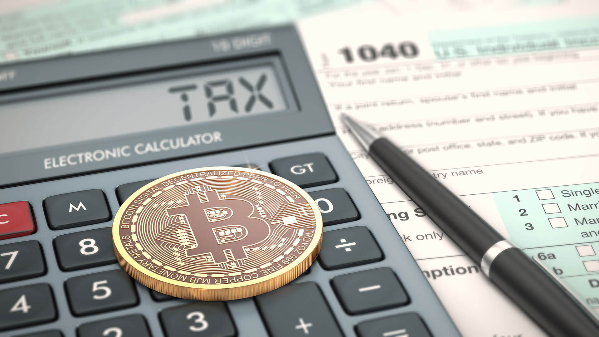 Bitcoin on top of calculator beside tax form and pen