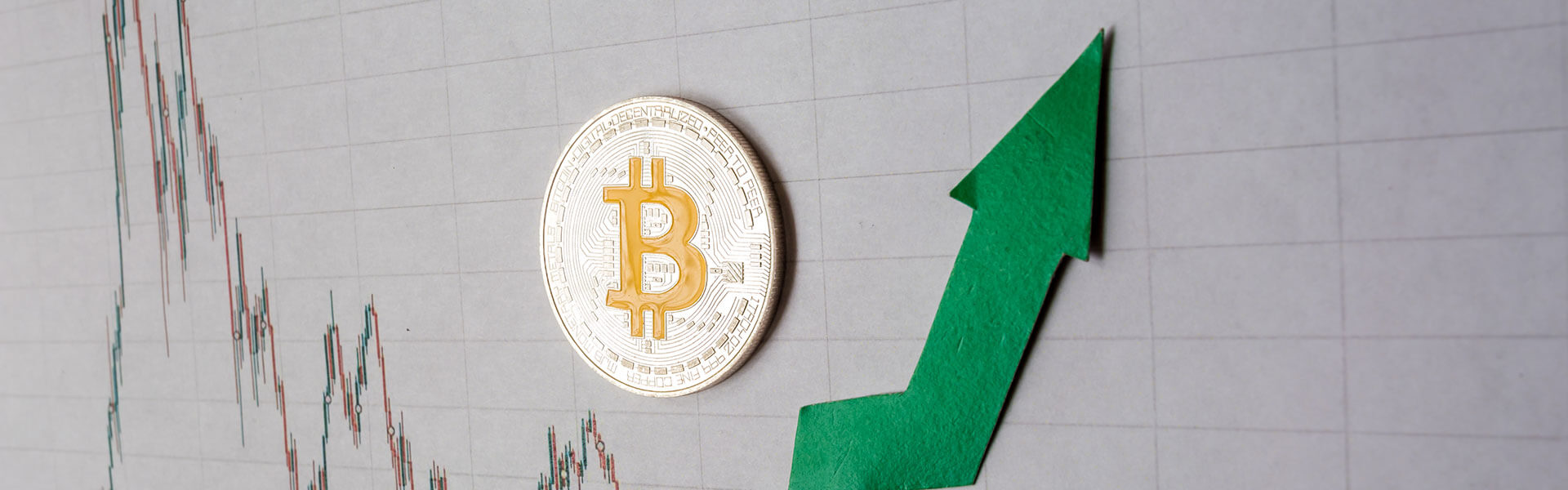 Green arrow and silver bitcoin on forex chart
