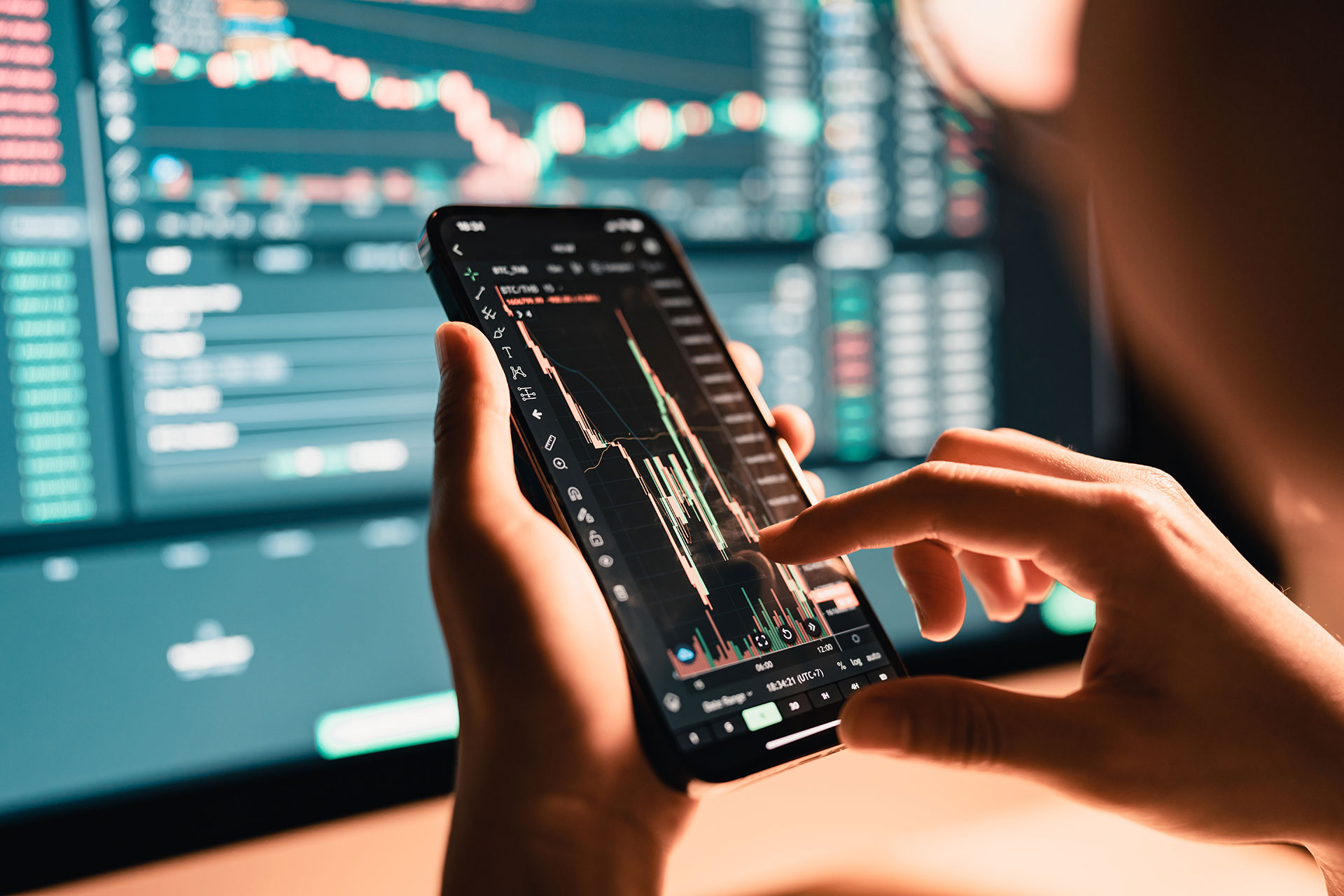 Person using mobile phone to trade cryptocurrency